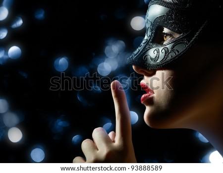 Stock Photo cute girl in masquerade mask
