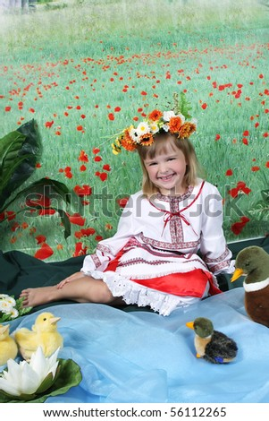 cute girl in national dress and a wreath