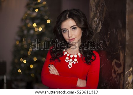 Cute girl in red dress with Christmas tree #523611319