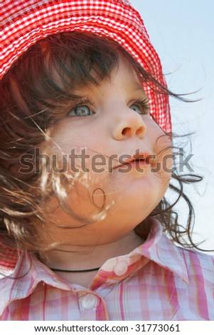 cute girl in red panama outdoor portrait