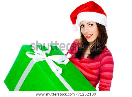 cute girl in Santa hat with gifts