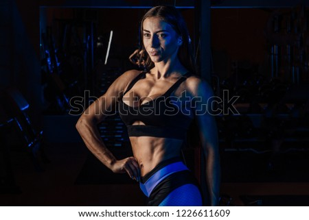 cute girl is engaged in the gym.young woman making exercise at the gym #1226611609