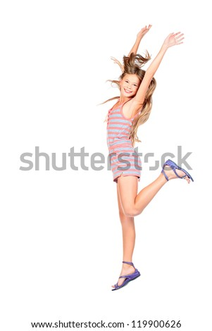 Cute girl jumping for joy. Isolated over white.