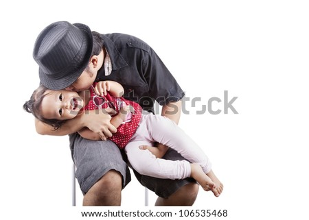 Cute girl kissed by her father, can be used as a symbol of father affection
