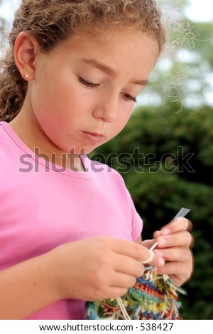 Cute girl knitting