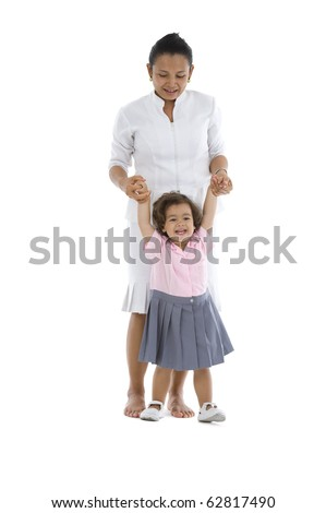 cute girl learning how to walk, isolated on white background