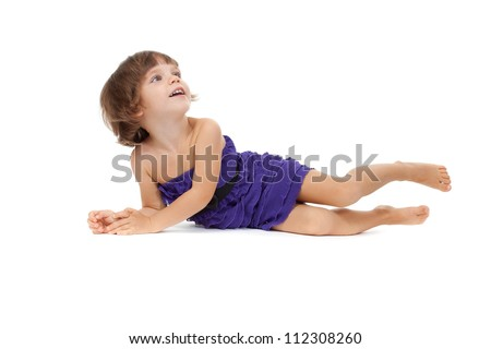 Cute girl lying on the floor - isolated over a white background