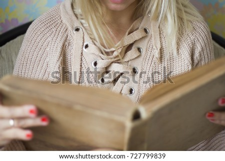 Cute girl on a comfortable chair with tea ,reading a book, the concept of comfort and hipster #727799839