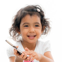 Cute girl on the phone. Adorable child pretending to talk on the phone. Small Asian female kid posing for photograph.