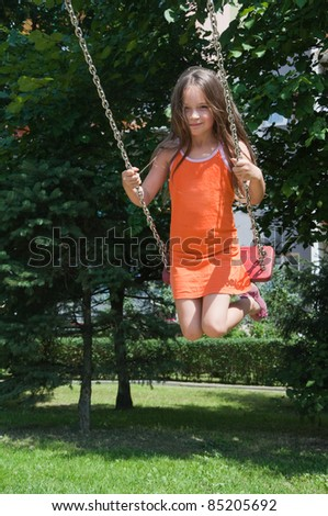 cute girl playing on the playground