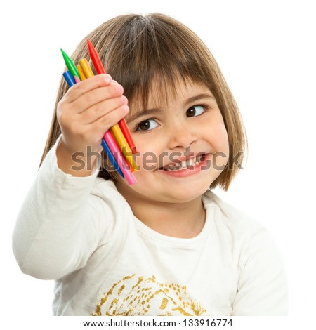 Cute girl showing color wax crayons.Isolated on white.