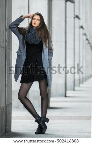 Cute girl stands on the background of building #502416808