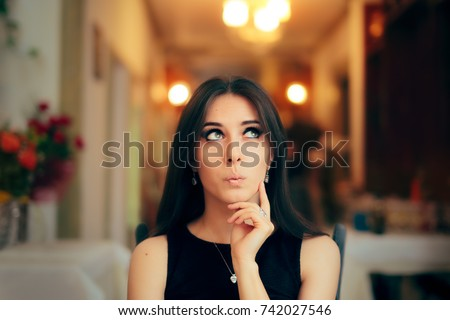 Cute Girl Thinking about Her Plan at Dinner Party - Funny schemer girl attending a fancy event making up excuses to leave