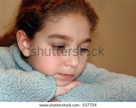 Cute girl thinking hard on her homework
