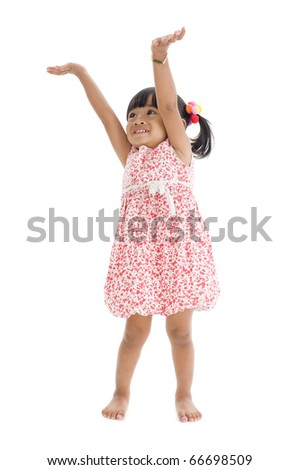 cute girl trying to reach something, isolated on white background