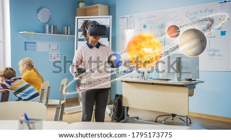 Cute Girl Wearing Augmented Reality Headset and Using Controllers Interacts with 3D Solar System. Futuristic School Science Class for Children Learning in STEM Programs. VFX, Special Effects Render