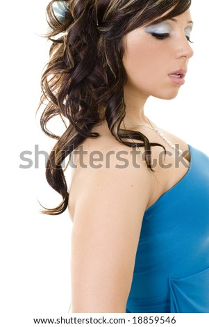 Cute girl wearing turquoise top looking down with her lips slightly parted