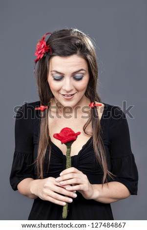 cute girl with a fabric red flower and heart hairpins
