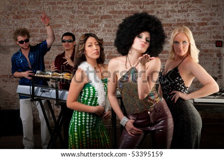 Cute girl with afro blowing a kiss at 1970s Disco Music Party