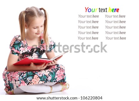 Cute girl with big book over white background - stock photo