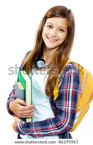 Cute girl with books smiling at camera in isolation