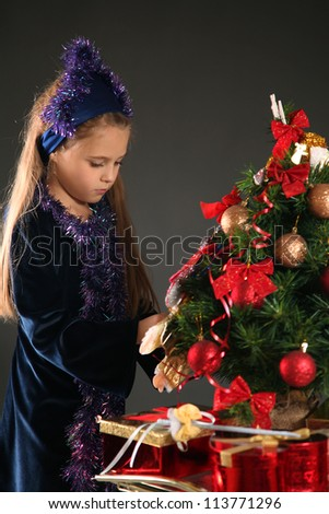 cute girl with christmas presents