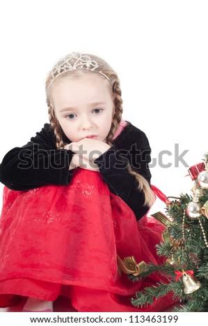 Cute girl with christmas tree - stock photo