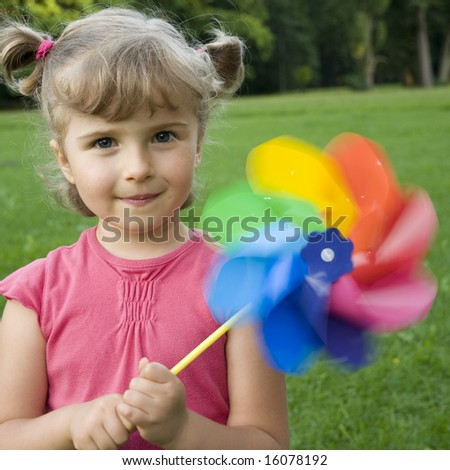 Cute girl with colored windmill toy
