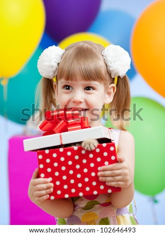 Cute girl  with colorful balloons and gifts