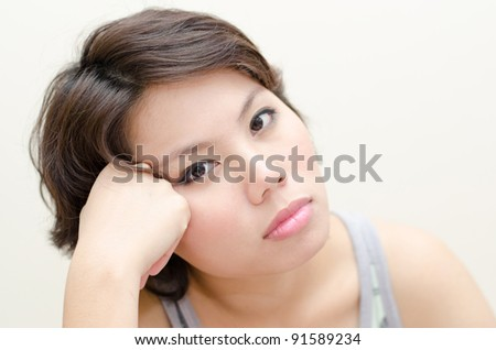 Cute girl  with face resting on fists - stock photo