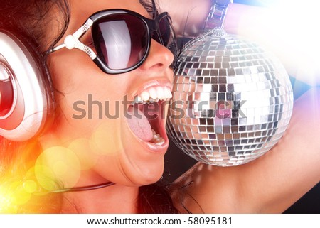 stock photo : Cute girl with headphones in nightclub
