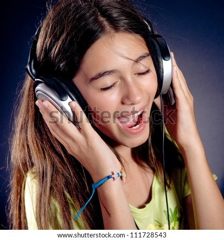 Cute girl with headphones singing.