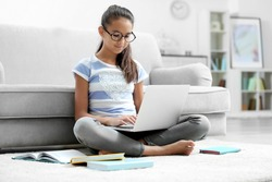 Cute girl with laptop at home