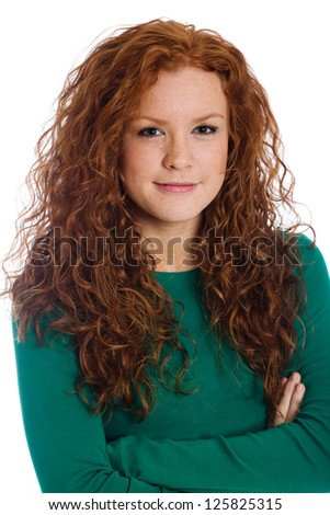Cute girl with red hair and crossed arms.
