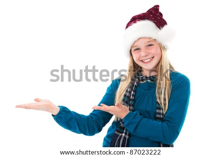 cute girl with santa hat isolated on white presenting copyspace