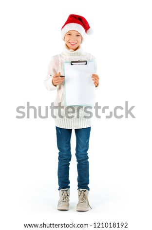 Cute girl with Santa hat showing a blank paper, whole figure
