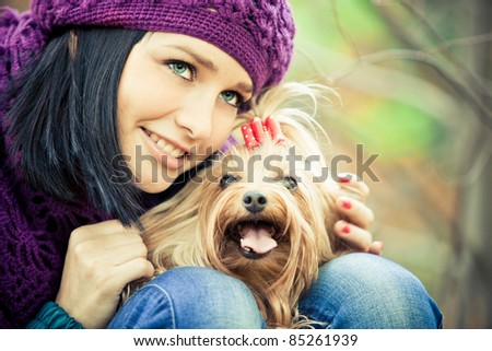 cute girl with small terrier dog
