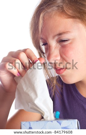 Cute girl with the sniffles taking a tissue