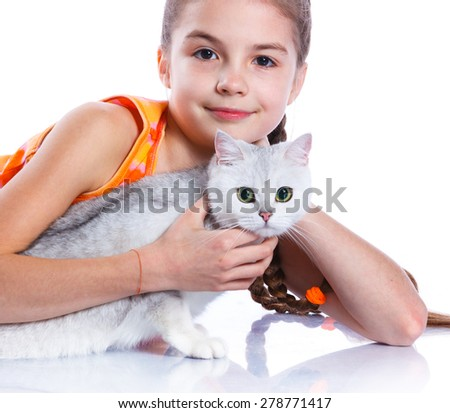 Cute girl with white cat smiling at camera on isolated white background. Focus of the cat