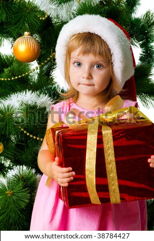 Cute girl with xmas gifts. Isolated on wite