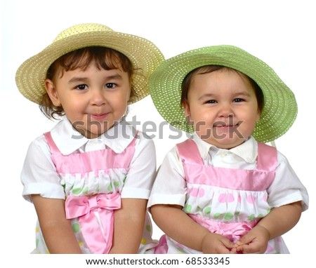 Cute girls in spring Easter dresses, two and three years, Hispanic