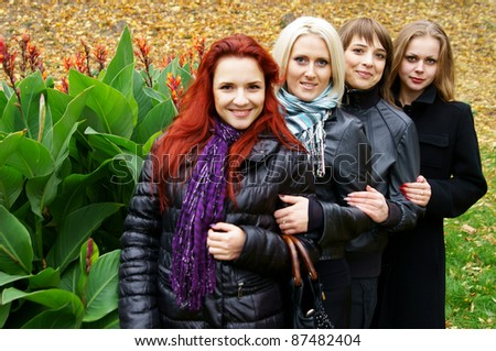 cute girls posing with flowers at nature