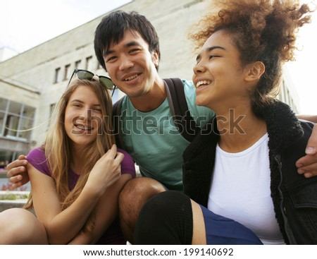 Cute Group Of Teenages At The Building University With Books Huggings 199140692