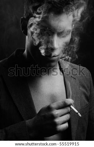 Cute guy smoking a cigarette