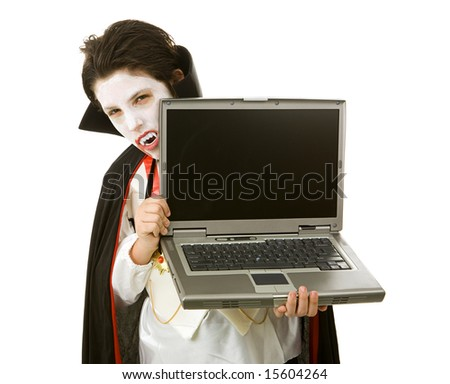 Cute Halloween vampire holding a laptop computer over white background.  LCD screen is blank and ready for your text.
