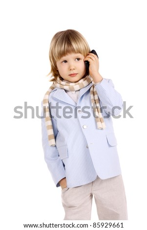 cute handsome little child speaking a mobile phone
