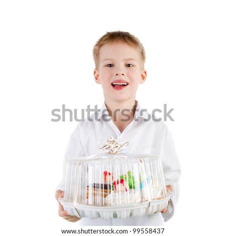 cute handsome smiling little boy holding the cake