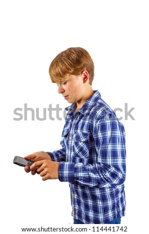 cute handsome young boy using his mobile phone