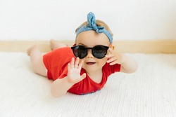 cute happy baby girl with sunglasses on white background, summer vacation concept