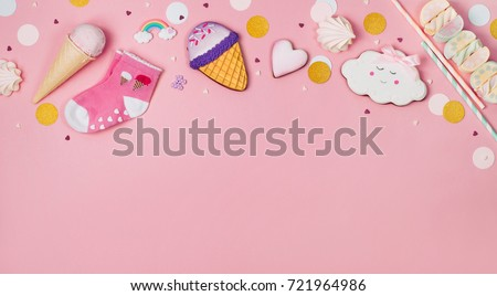Cute Happy Birthday party background: Ice cream cone, gingerbread and marshmallows on the pink background with blank space for text; top view, flat lay